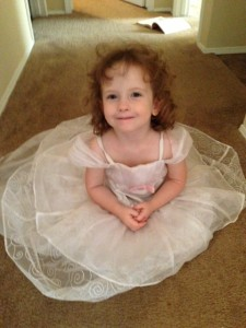 Amelia, 3, loves to play dress up and imitate her sisters.