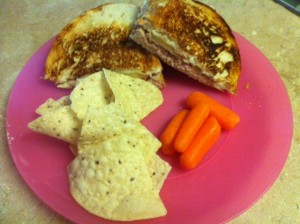 A grilled tuna sandwich on sourdough bread is a favorite at our house. My girls love carrots and chips, too. Yum!