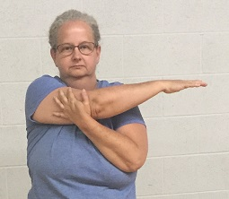 Arm stretch is an easy stretch for flexibility that loosens shoulder muscles.