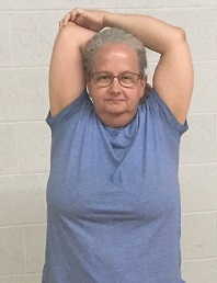 Shoulder side stretch is an easy stretch for flexibility that loosens neck muscles.